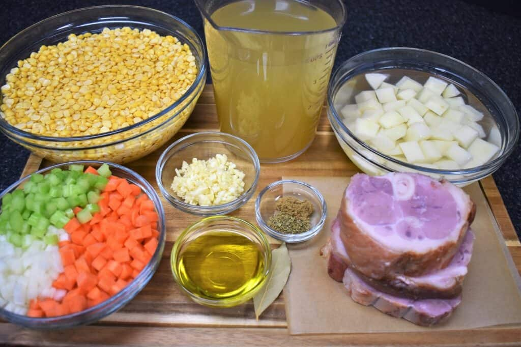 The ingredients for the Cuban split pea soup arranged on a wood cutting board