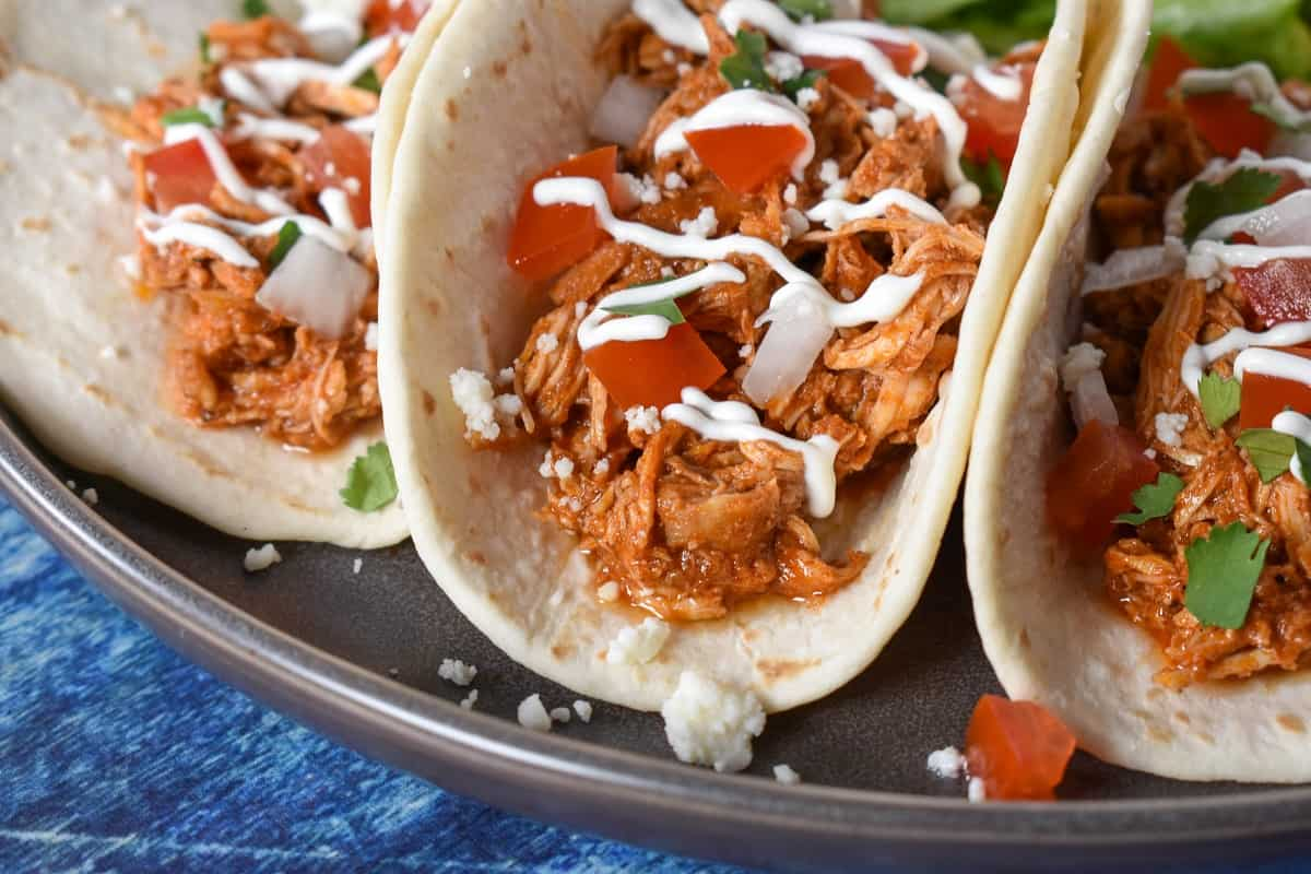 Shredded chicken served in flour tortillas and topped with diced tomatoes, onions, sour cream and cilantro.