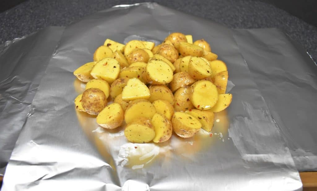 Honey Gold potatoes on aluminum foil.