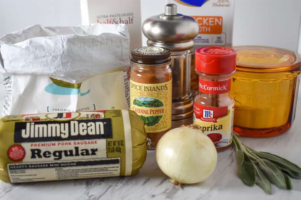 The ingredients for the sausage gravy displayed on a white table.