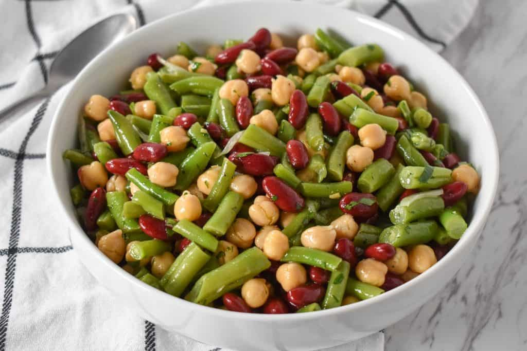 Three Bean Salad served in a large, white platter.