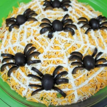 A bean dip with spiders made from black olive pieces.