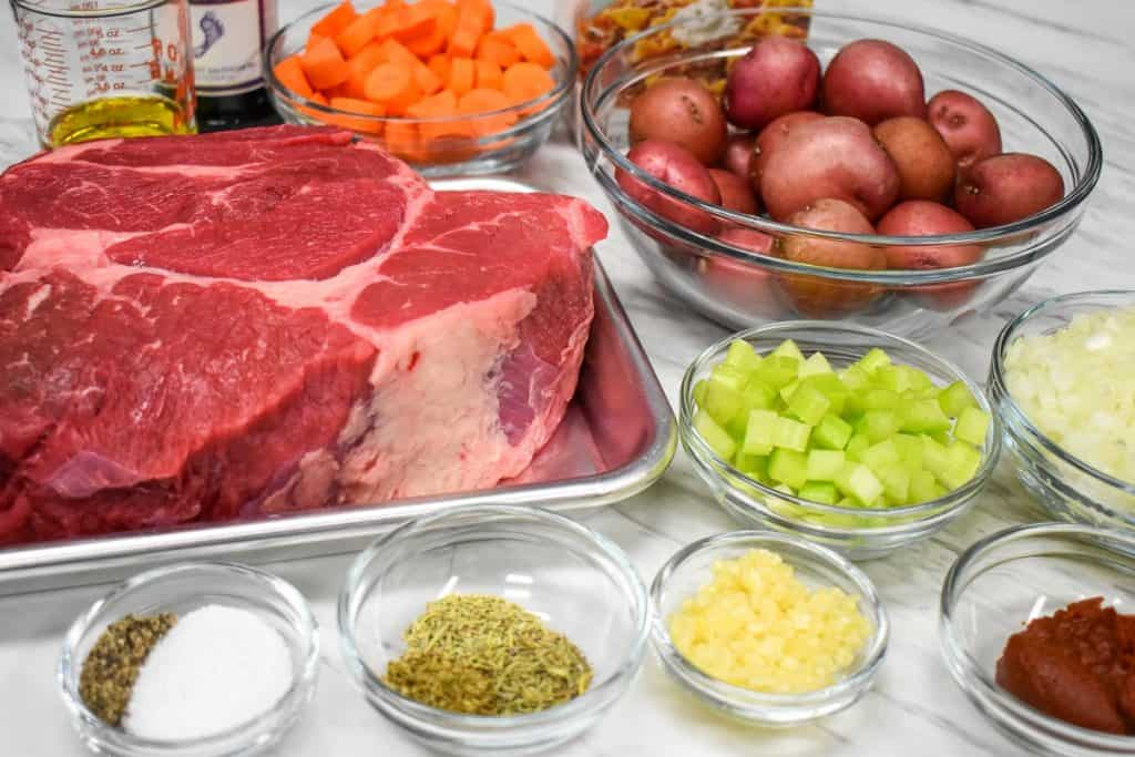 The ingredients for the stovetop pot roast arranged on a table.