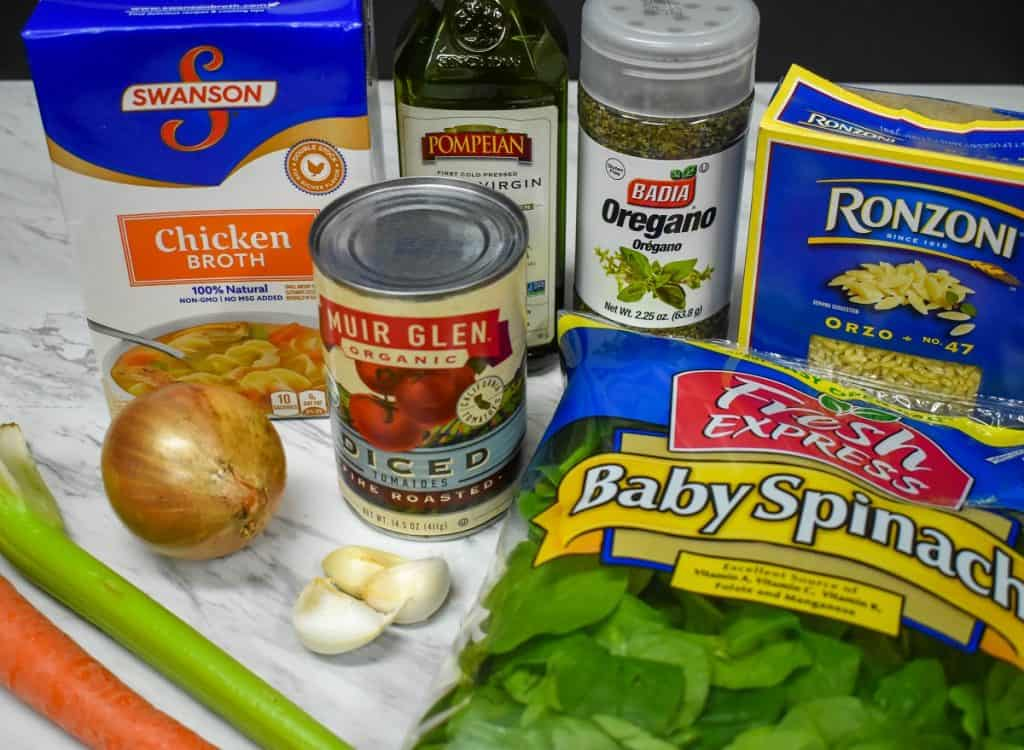 The ingredients for the soup component displayed on a white table.