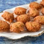 Malanga Fritters displayed on a white platter.