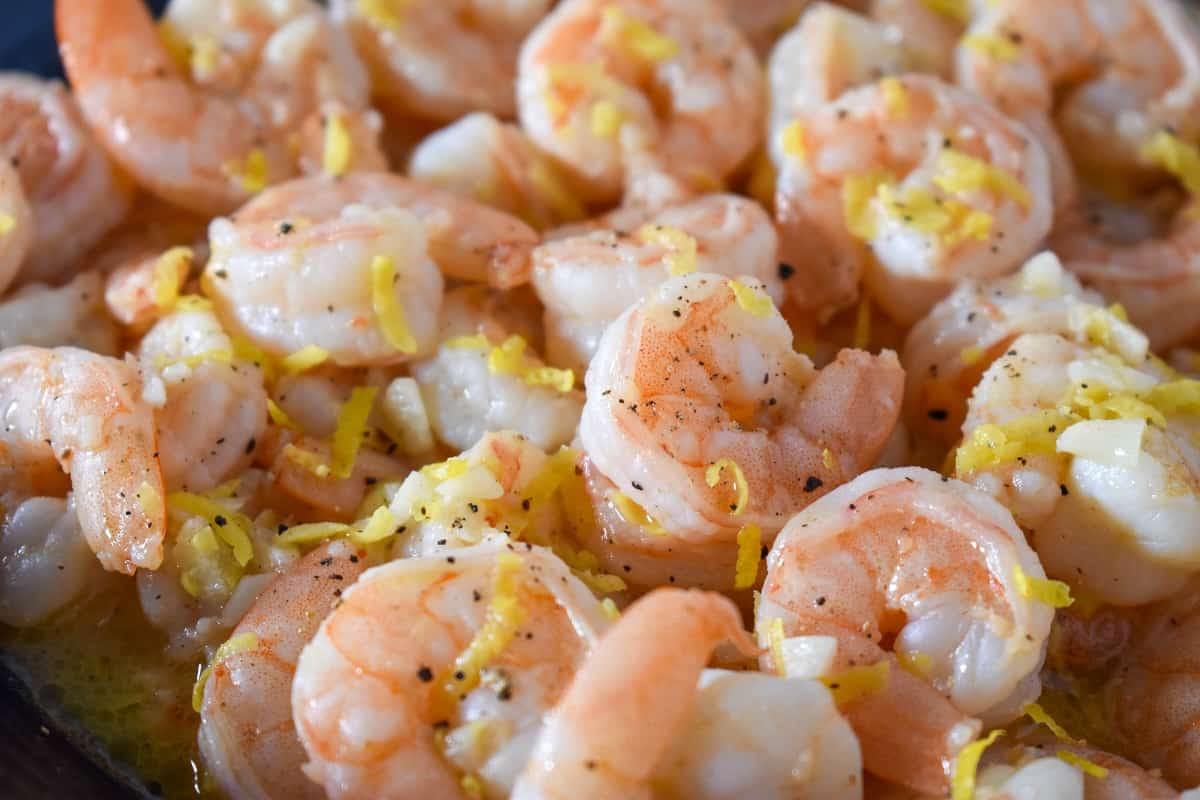 A close up image of lemon pepper shrimp.