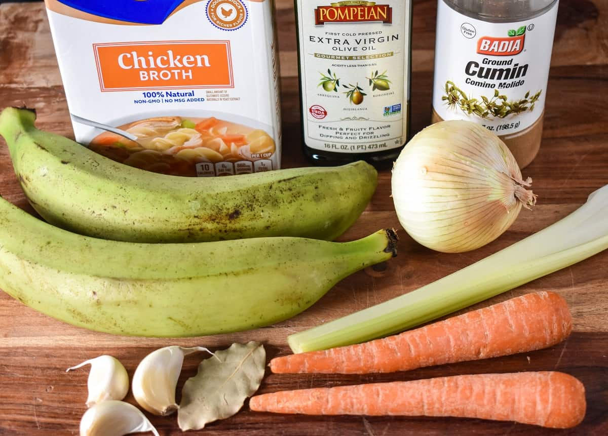 The ingredients for the soup displayed on a wood cutting board.