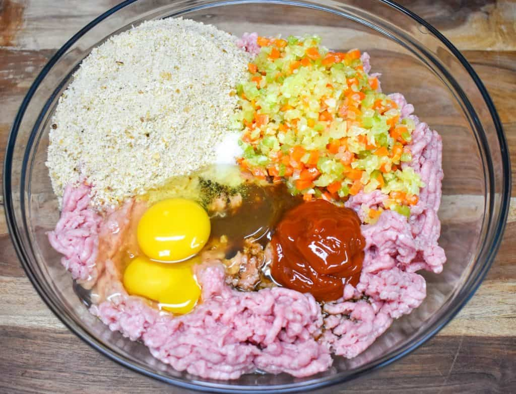 The ingredients in a large, glass bowl before being mixed.