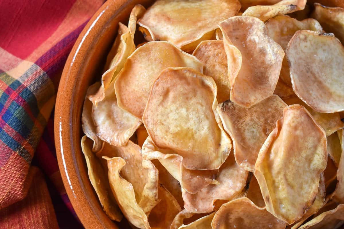 A close up image of the malanga chips served in a terracotta bowl.