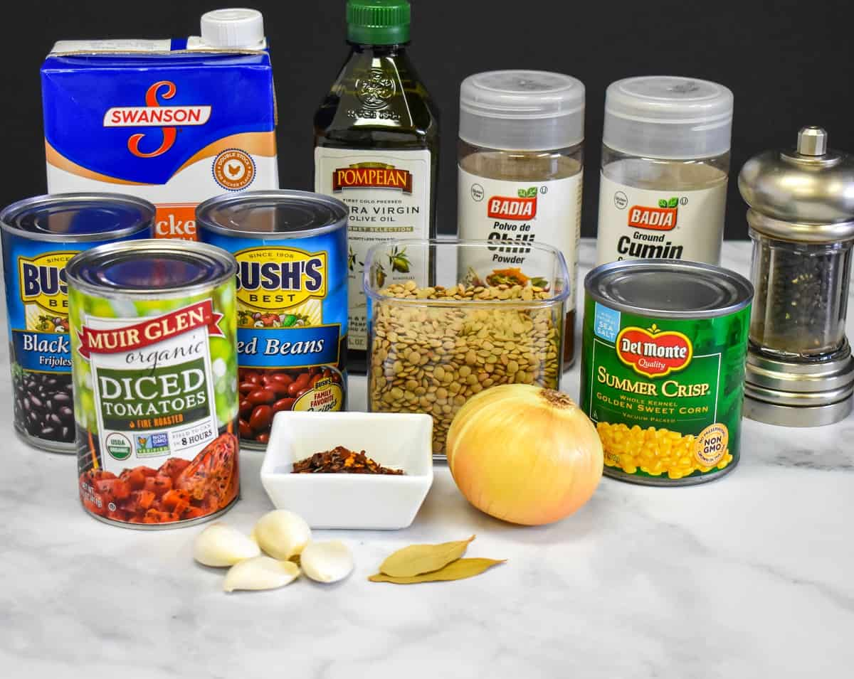 The ingredients for the chili arranged on a white table.