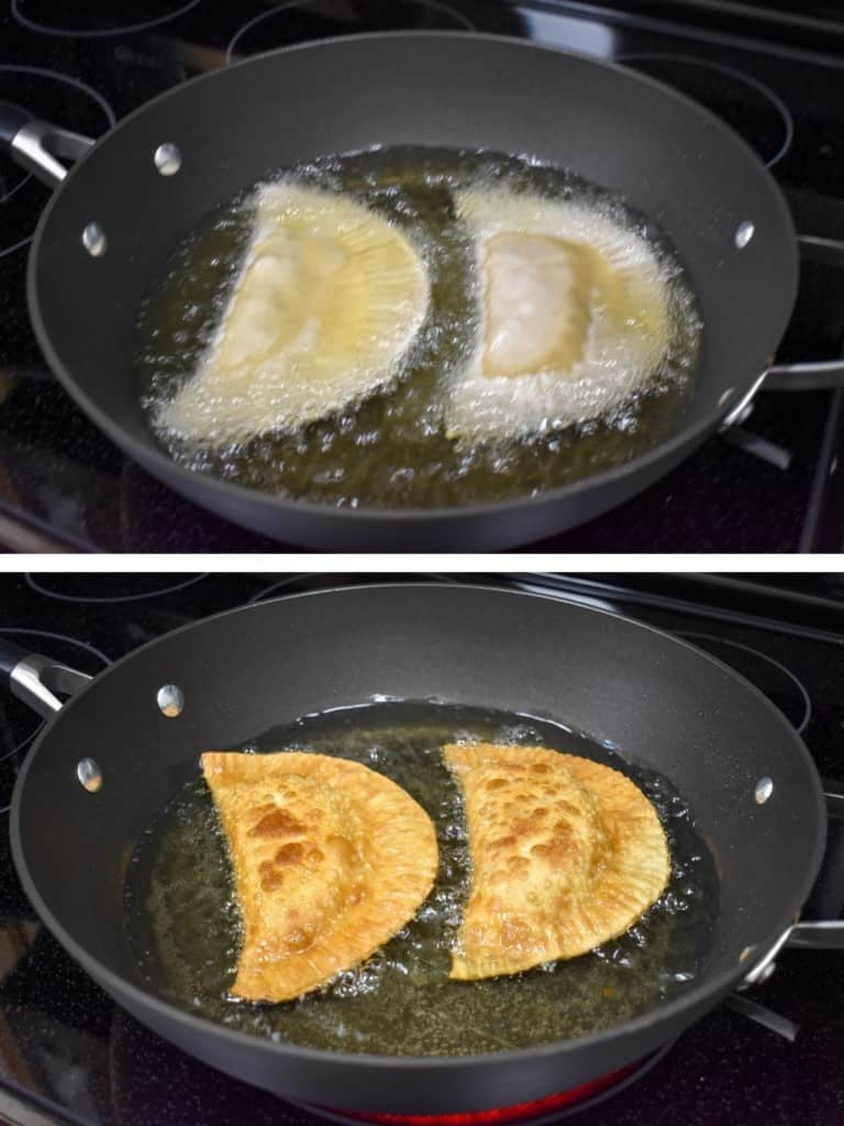 Two images of two empanadas frying in a large, black skillet. The top image is when they were first added and the second is when one side is golden brown.