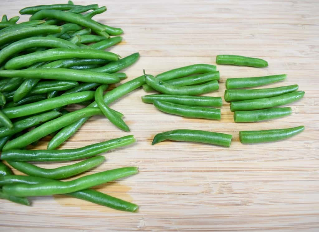 Green beans on a wood cutting board.