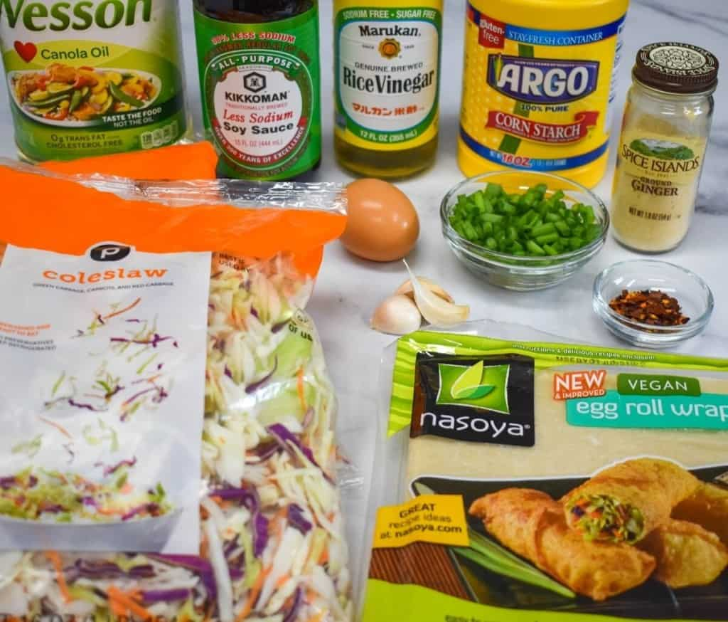 The ingredients for the vegetable egg rolls arranged on a table.