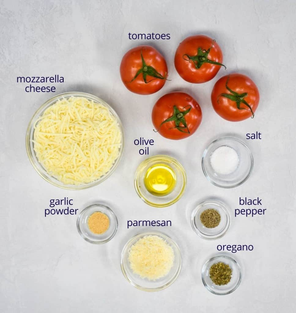 The ingredients arranged in glass bowls on a white table. Each one has a label in dark blue letters above or beside it.