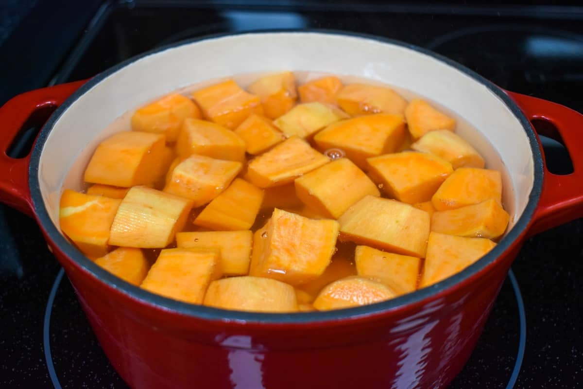 Cut sweet potatoes in a pot with water.